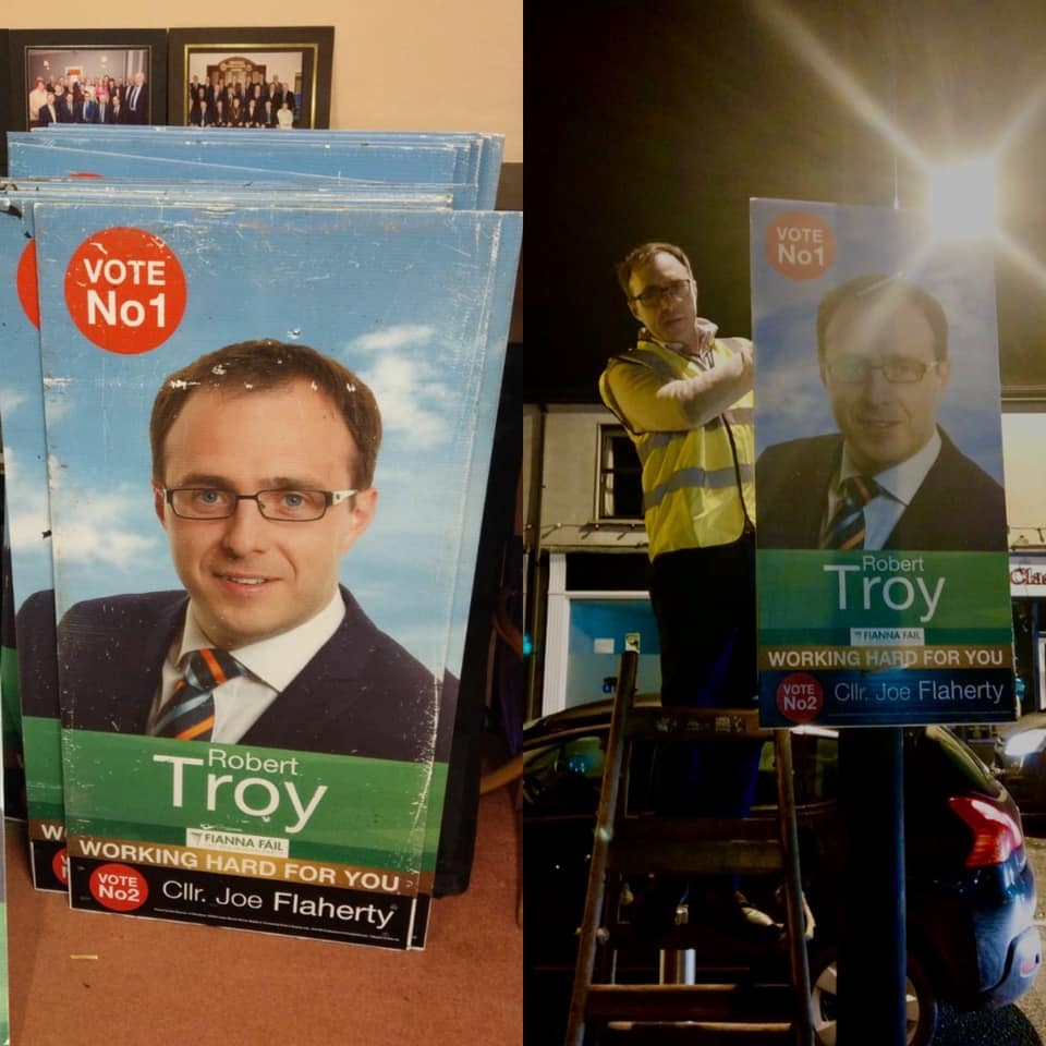 Photo of Robert Troy TD hanging a poster for his Election 2020 campaign